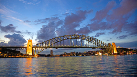 steel bridge: Tourists walk across the iconic Sydney Harbour Bridge at night  This steel arch bridge across Sydney Harbour carries rail, vehicular, bicycle and pedestrian traffic between the Sydney CBD and the North Shore