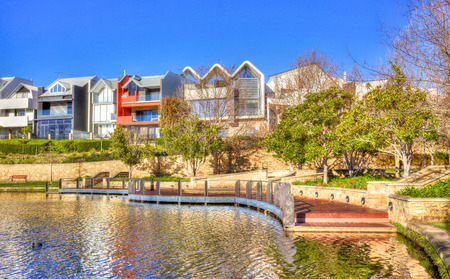 mere: Early in the morning at Subiaco Mere against a backdrop of contemporary residences, in the trendy suburb of Subiaco in Perth, Western Australia   Stock Photo