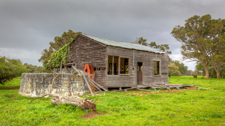 homestead: An old abandoned farmhouse near the town of Karridale in the Margaret River region of Western Australia. HDR image. Stock Photo