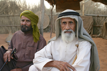 gcc: Two Arab men at their camp near Dubai. The older man on the right is blind.