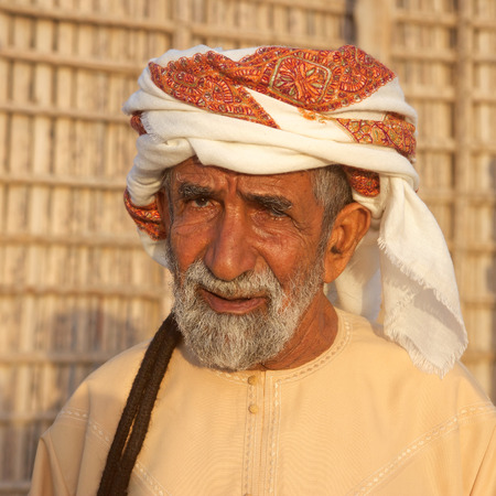 headcloth: Portrait of an elderly Omani man wearing a traditional headcloth near Muscat in the Sultanate of Oman.