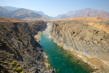 Wadi: Water has cut through desert rock to create Wadi Dyqah, one of the most beautiful natural landscapes in the Sultanate of Oman.