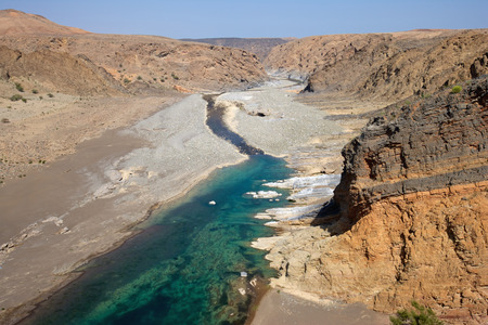 Water has cut through desert rock to create Wadi Dyqah, one of the most beautiful natural landscapes in the Sultanate of Oman.