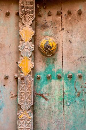 Detail of an old door in the ruins of Birkat Al Mouz in the Nizwa area of Oman.