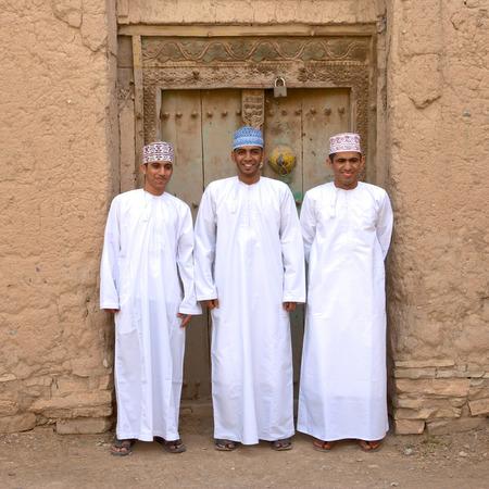 birkat: BIRKAT AL MOUZ, OMAN ? FEBRUARY 2, 2008: Three young Omani men in traditional dress at the ruins of Birkat Al Mouz in the Nizwa area of the Sultanate of Oman.