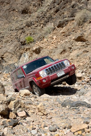 4wd: A Dubai-registered Jeep Commander 4x4 vehicle negotiates a rocky track in the desert interior of the Sultanate of Oman.