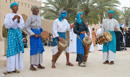 providing: Omani musicians providing music for a tribal dance in Muscat, in the Sultanate of Oman.