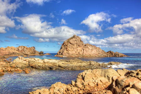 First light on Sugarloaf Rock, a famous coastal landmark near the town of Dunsborough in South-West Australia. The rock is the world