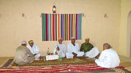 meeting place: Omani men relaxing in their majlis (traditional meeting place) in Muscat, in the Sultanate of Oman.