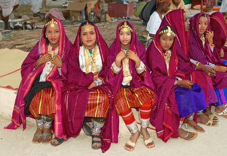 muscat: Omani girls in traditional dress take a break during a cultural festival in Muscat, in the Sultanate of Oman. Editorial