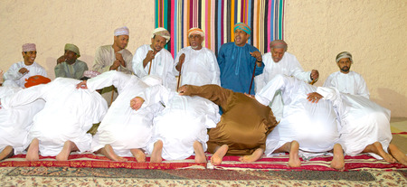 meeting place: Omani men performing a ritual in their majlis (traditional meeting place) in Muscat, in the Sultanate of Oman.