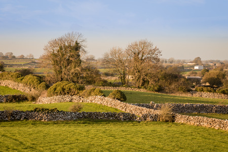 stonemasonry: Meadows and stone walls in Cloughanover, near Headford in County Galway, Ireland.
