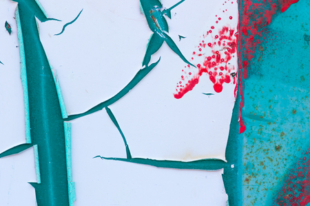 rust red: Abstract of peeling white paint on a turquoise background with red splatters and rust  marks. Stock Photo