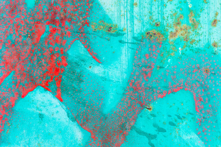 texture backgrounds: Abstract of red paint splatters and rust  marks on a turquoise background .