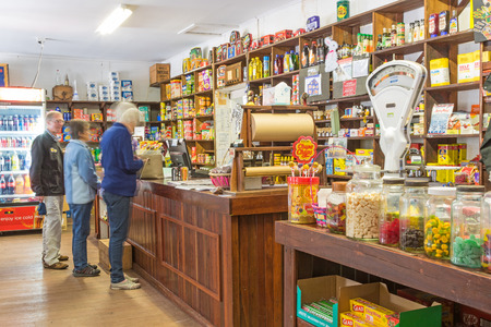 quaint: ROSA BROOK, AUSTRALIA - APRIL 5, 2016: Unidentified customers in Darnells General Store in Rosa Brook, in the Margaret River area of Western Australia. The store  is a nostalgic and quaint reminder of the past.