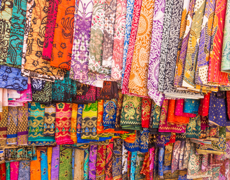 souvenir: Colorful sarongs on sale in the market at Ubud in Bali, Indonesia.