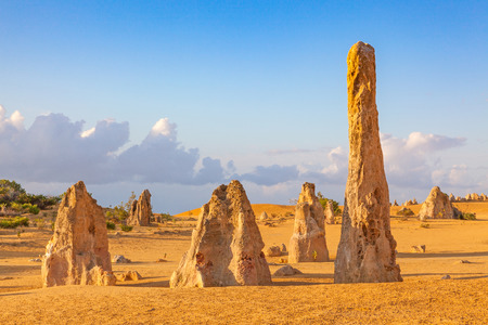 contained: The Pinnacles are limestone formations contained within Nambung National Park, near the town of Cervantes, Western Australia.