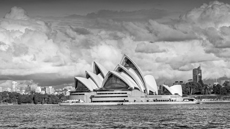 SYDNEY, AUSTRALIA - MAY 20, 2010: A view of Sydney Opera House from the water. With its interlocking roof or shells it is Australias most recognisable building and a UNESCO World Heritage Site.