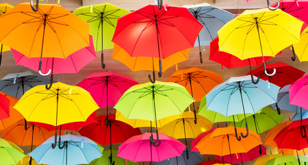 yellow green: Colorful umbrellas hanging from a roof, creating an interesting abstract background.