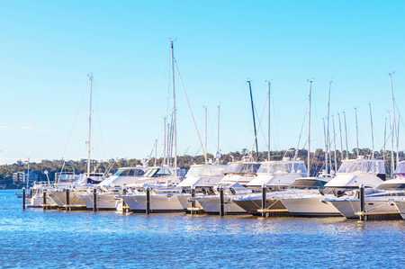 moorings: Boats lined up at their moorings in the Swan River in Perth, Western Australia.