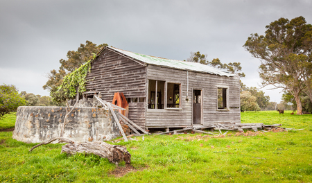A storm approaching an abandoned farmhouse near the hamlet of Karridale in the Margaret River region of Western Australia. Stock Photo