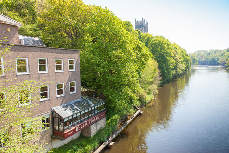 durham: DURHAM, UK - MAY 22, 2012: Diners in a restaurant overlooking the banks of the River Wear in Durham, England.