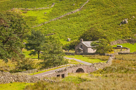 erected: St Martins Church is located in the valley of Martindale in Cumbria, in the English Lake District. The present building was probably erected at the end of the 16th century. Stock Photo