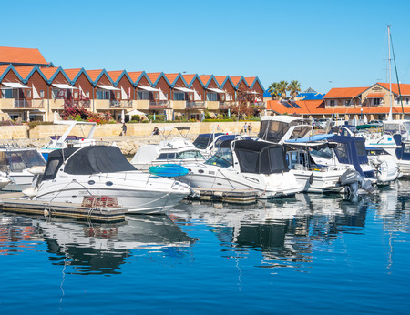 perth: HILLARYS, AUSTRALIA – MAY 25, 2017: Boats moored at Hillarys Boat Harbour, a marina and tourist precinct located in Hillarys, north of Perth in Western Australia. Editorial