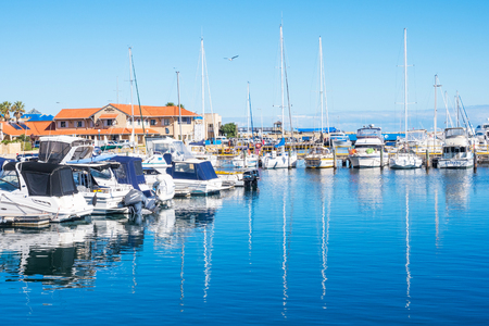 moorings: HILLARYS, AUSTRALIA – MAY 25, 2017: Boats moored at Hillarys Boat Harbour, a marina and tourist precinct located in Hillarys, north of Perth in Western Australia.