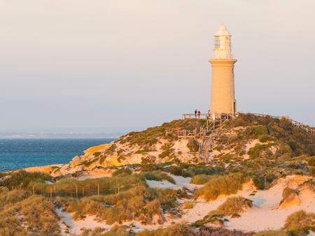 pinky: ROTTNEST ISLAND, WESTERN AUSTRALIA – APRIL 16, 2017: Tourists enjoying the golden hour at Bathurst Lighthouse on Rottnest Island, near Perth in Western Australia.
