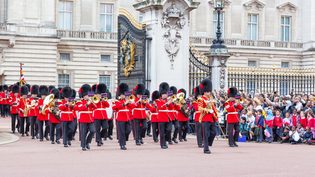 LONDON, UNITED KINGDOM – JULY 11, 2012: The band of the Coldstream Guards marches out of Buckingham Palace during the Changing of the Guard ceremony.