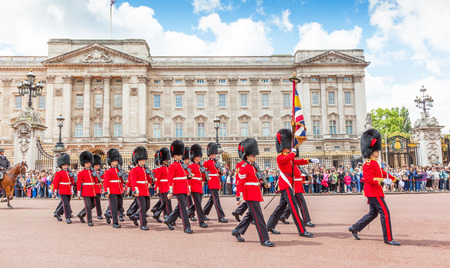 LONDON, UNITED KINGDOM – JULY 11, 2012: Officers and soldiers of the Coldstream Guards march in front of Buckingham Palace during the Changing of the Guard ceremony