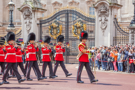LONDON, UNITED KINGDOM – JULY 11, 2012: The band of the Grenadier Guards, led by a Drum Major of the Coldstream Guards, marches past the front of Buckingham Palace during the Changing of the Guard ceremony.