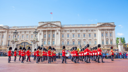 LONDON, UNITED KINGDOM – JULY 11, 2012: The band of the Grenadier Guards, led by a Drum Major of the Coldstream Guards, marches past the front of Buckingham Palace during the Changing of the Guard ceremony. Editorial