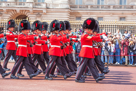 LONDON, UNITED KINGDOM – JULY 11, 2012: Soldiers of the Coldstream Guards march past the front of Buckingham Palace during the Changing of the Guard ceremony.