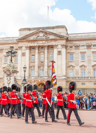 LONDON, UNITED KINGDOM – JULY 11, 2012: Officers and soldiers of the Coldstream Guards march in front of Buckingham Palace during the Changing of the Guard ceremony.