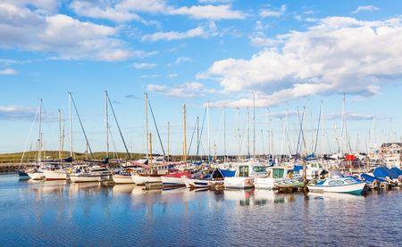 Yachts moored at Amble Marina, on the banks of the River Coquet in the unspoilt Northumberland countryside of England.