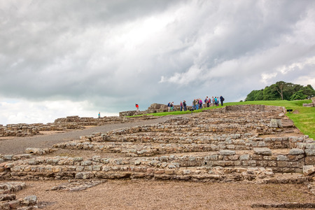 NORTHUMBERLAND, ENGLAND - JULY 7, 2012: The remains of Housesteads Roman Fort, part of Hadrians Wall in Northumberland, England.