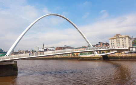 NEWCASTLE UPON TYNE, ENGLAND - JULY 5, 2012: A view of Gateshead Millennium Bridge, which crosses the  River Tyne, in Newcastle Upon Tyne in the North East of England.