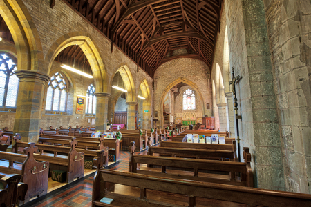 HARBURY, ENGLAND - AUGUST 10, 2012: Interior of the parish church of All Saints in Harbury in Warwickshire, England. It was first built in the Medieval period, but rebuilt and much altered in more recent times. Editorial