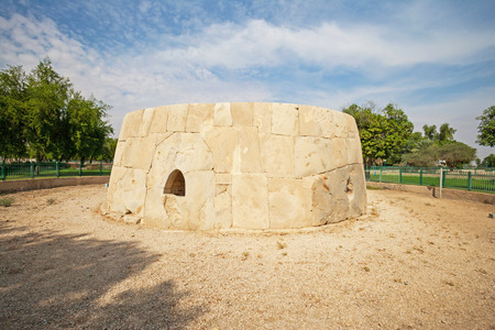 The Great Hili Tombi in Hili Archaeological Park, a Bronze Age site in Al Ain, Emirate of Abu Dhabi, United Arab Emirates. Its two entrances are decorated with iconic carvings of humans and oryx antelope.