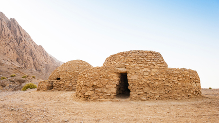 The Jebel Hafeet Tombs are 5,000 year old beehive tombs composed of stacked natural and edged stones. The site is located near the Omani border on the east side of Al Ain in the UAE. Stock Photo