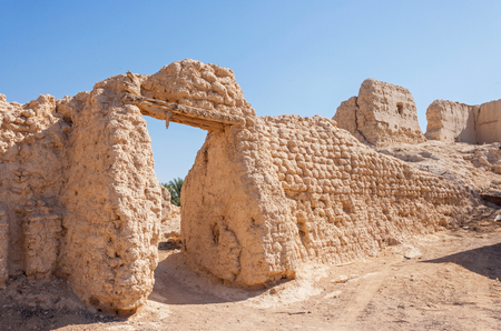 Ruins of an old settlement in an oasis in Al Ain, in the emirate of Abu Dhabi, United Arab Emirates. Stock Photo