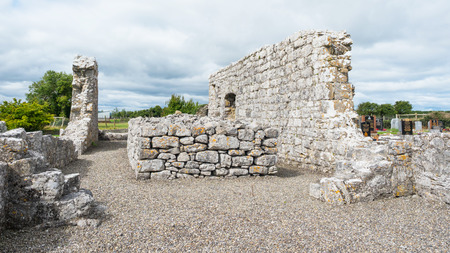 ANNAGHDOWN, IRELAND - AUGUST 13, 2018: The ruins of one of the churches in the Annaghdown Churches complex in County Galway in Ireland.