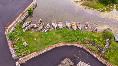 An aerial view of rowing boats at Kilbeg Pier near Headford in County Galway, Ireland.