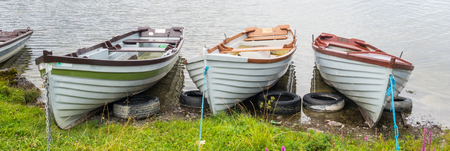 Rowing boats at Kilbeg Pier near the town of Headford in County Galway, Ireland.