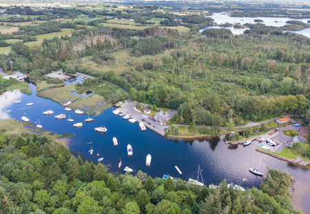 An aerial view of leisure boats at Lisloughrey Pier near the village of Cong in County Galway, Ireland. Фото со стока