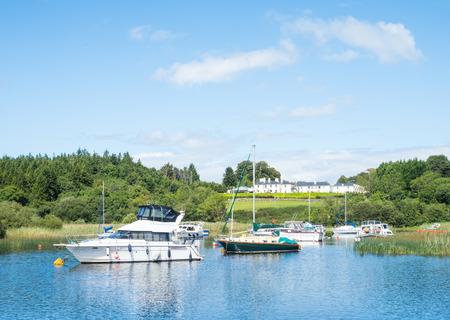 Leisure boats at Lisloughrey Pier near the village of Cong in County Galway, Ireland.