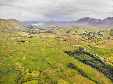 An aerial view of the R336 road between the small villages of Leenaun and Maum in Connemara, County Galway, Ireland. Stock Photo