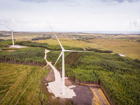 An aerial view of  wind turbines in a rural area between the towns of Spiddal and Moycullen in County Galway, Ireland